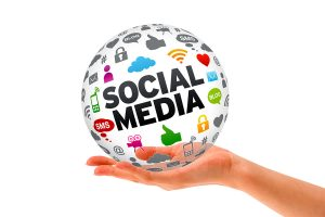 Hand holding a Social Media 3d Sphere sign on white background.